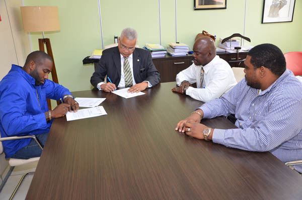 Prime Minister Gumbs signs for  Middle Region sewage connections